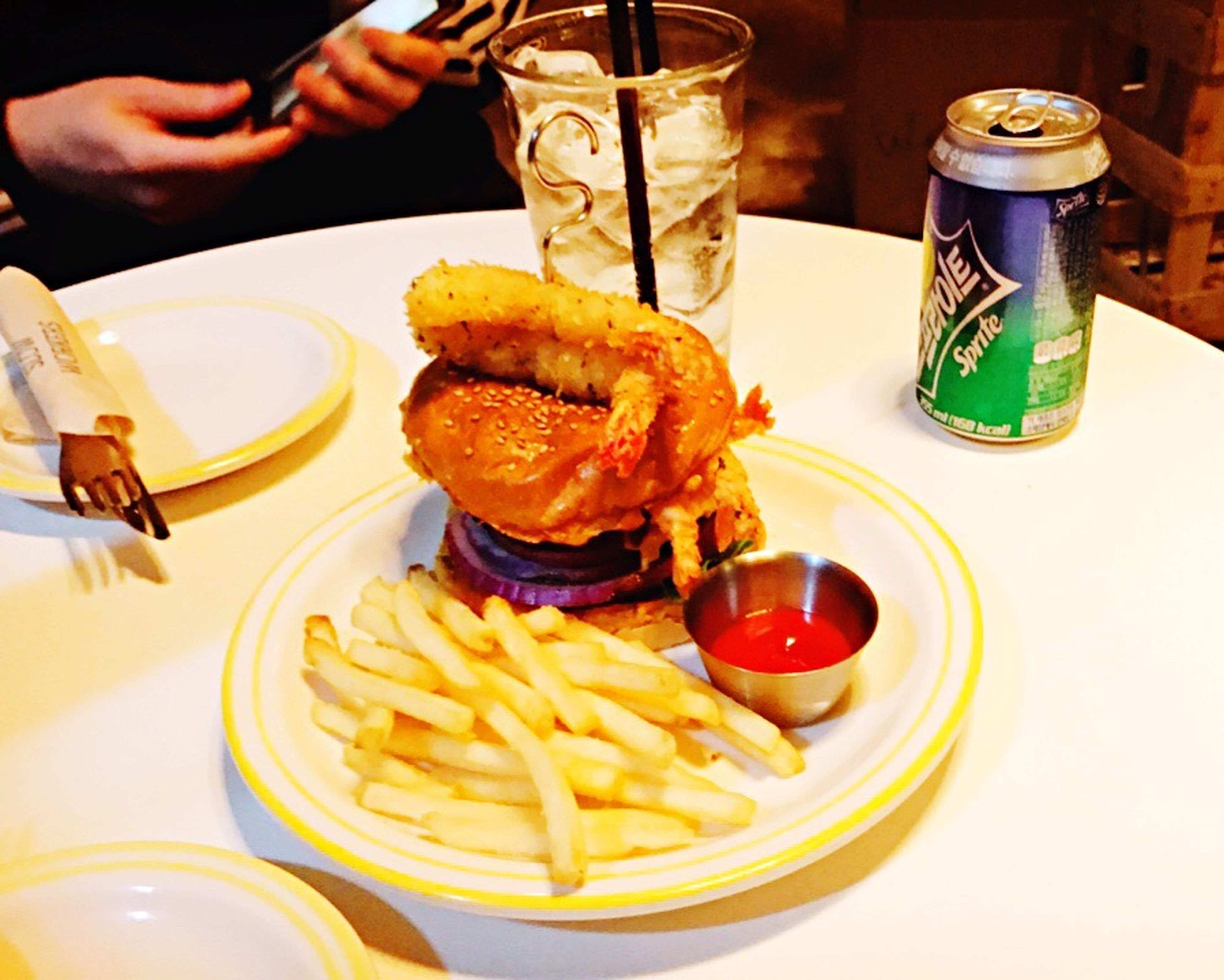 food and drink, unhealthy eating, french fries, food, plate, table, ready-to-eat, deep fried, indulgence, prepared potato, adults only, drink, freshness, people, indoors, one person, close-up, fast food, human body part, human hand, adult, day