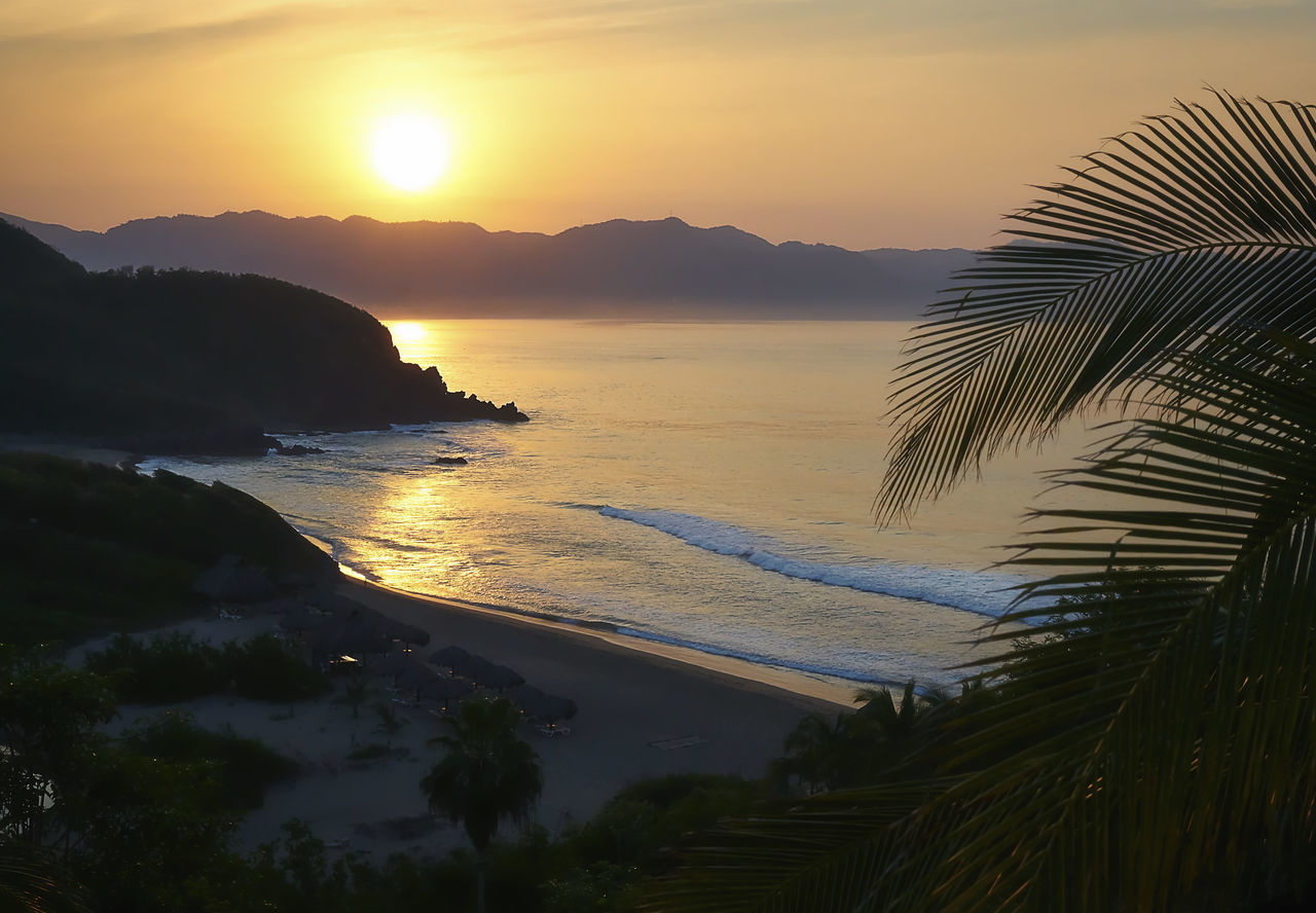 Sunrise over a bay in Jalisco, Mexico. Bay Beach Bikini Clothing Optional Holiday Horizon Over Water Jalisco Landscape Mexico Nature Outdoors Pacific Ocean Resort Scenics Sea Sky Sunrise Sunset Travel Travel Destinations Vacations Water
