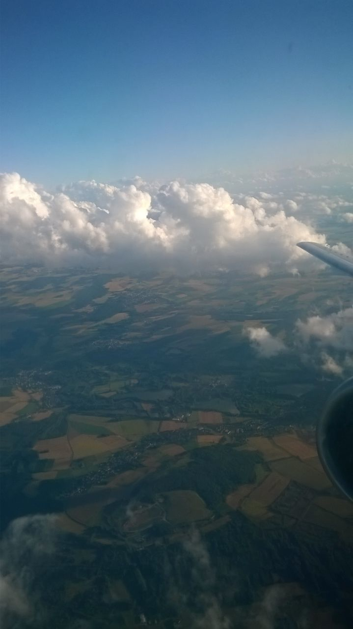 aerial view, beauty in nature, nature, scenics, tranquil scene, tranquility, landscape, travel, outdoors, no people, cloud - sky, sky, day, patchwork landscape, agriculture, journey, airplane, view into land, flying, airplane wing