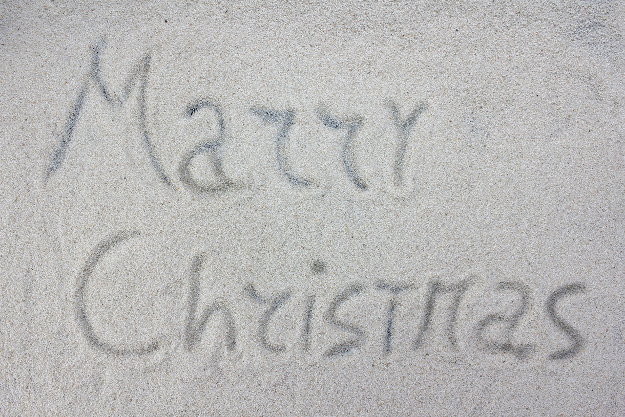 Merry Christmas written on the white snow Background Celebration Christmas Claus December Decoration Festive Holiday Merry Santa Sky Snow White Winter Xmas