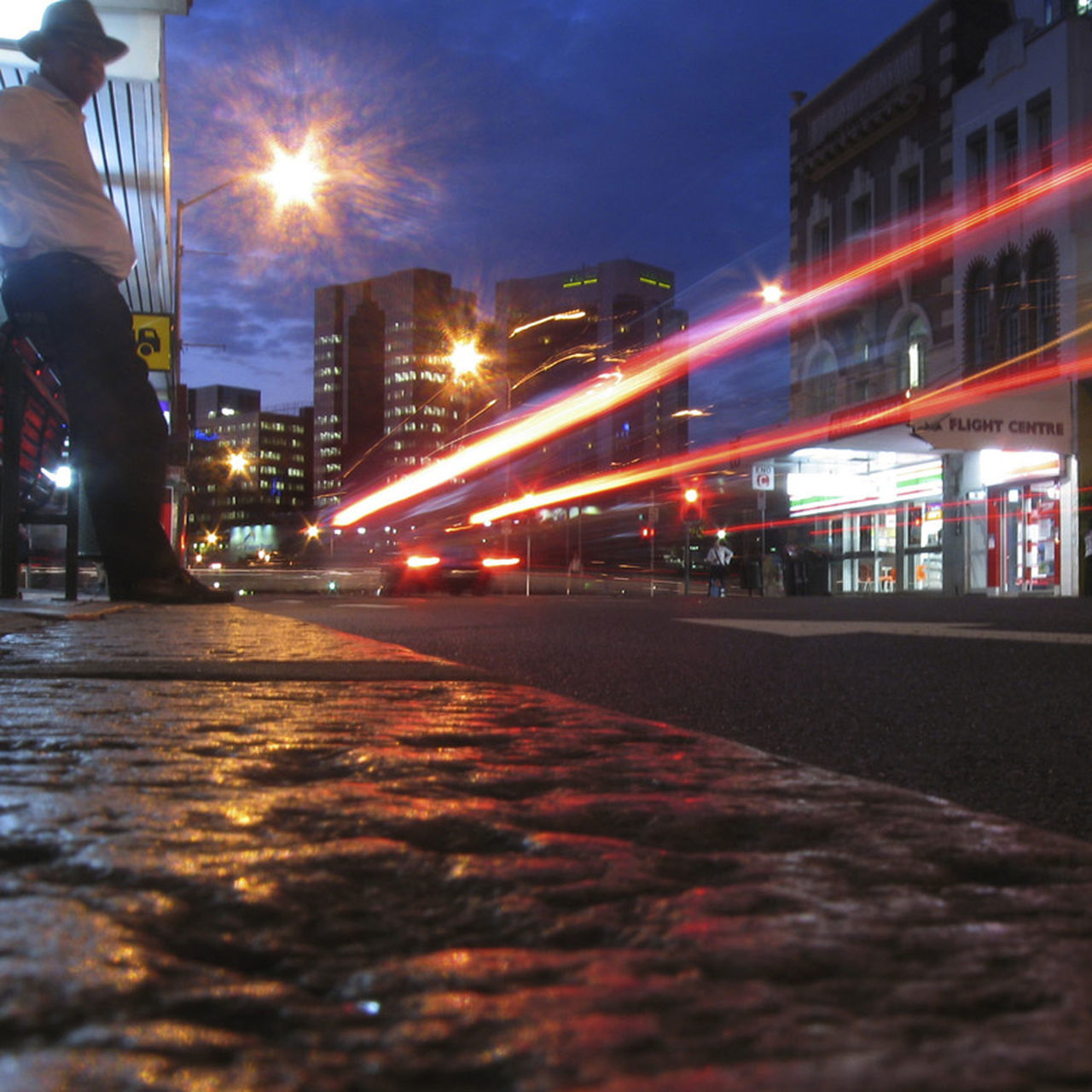 illuminated, night, long exposure, motion, speed, blurred motion, street, architecture, outdoors, real people, building exterior, road, transportation, built structure, one person, sky, men, city, people