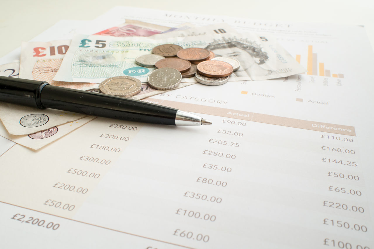 Monthly Budget concept with Pound Sterling paper money and coins. British Budget Business Coins Currency Day England Finance Handwriting  Money No People Paper Planning Pound Pound Sterling Shillings And Pence Sterling Text United Kingdom Wealth