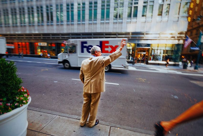 Hailing a cab in midtown Manhattan NYC Photography Street Real People FedEx Truck Cab Street Photography