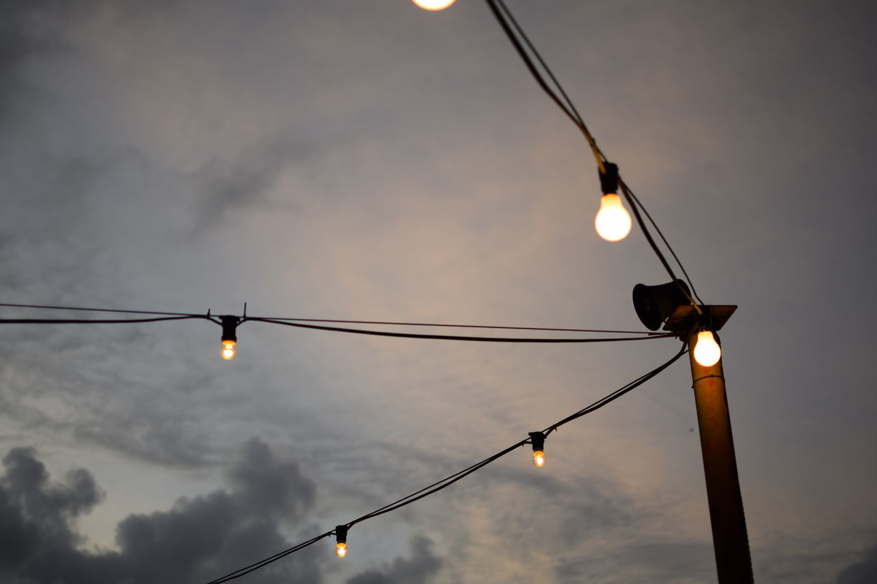 Under dark sky. Electricity  Low Angle View Sky No People Cable Cloud - Sky Outdoors Nature Beauty In Nature Bulbs Lighting Dusk