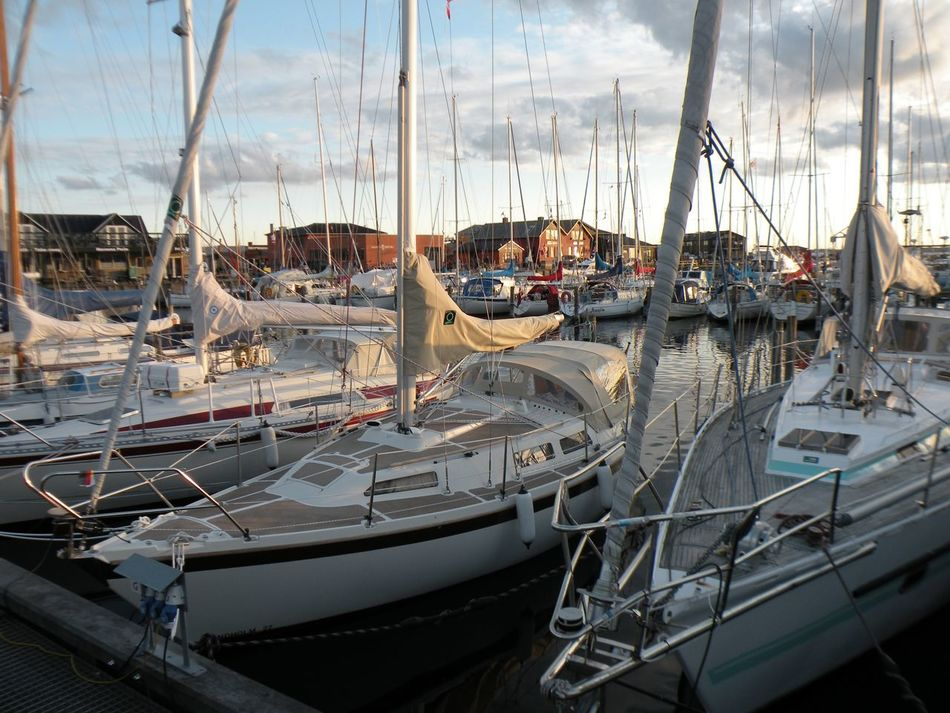 Sailboats in Hundested Harbour on the island of Zealand in Denmark - Nautical Vessel Transportation Moored Boat Mode Of Transport Sailboat Harbor Mast Water Cloud Sea Sky Calm Waterfront Ocean Marina Day Outdoors Tranquility No People Hundested Hundested Harbour Zealand Denmark