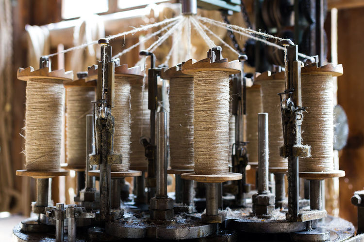 Making ropes the old way. Arrangement Close-up Craftsmanship  Focus On Foreground Group Of Objects Handmade In A Row Machine Part Making Rope Old Repetition Rope Ropemaker Selective Focus Side By Side Spinning Technical Detail Technology Wood - Material