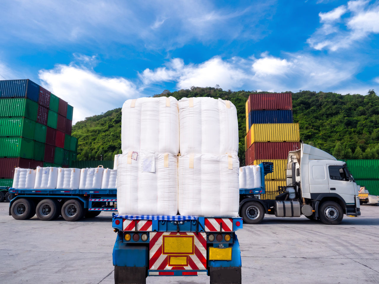 The truck to delivery tapioca in jumbo bag at the port Freight Transportation Commercial Land Vehicle Truck Container Semi-truck Industry Business Finance And Industry Cargo Container Transportation Shipping  Stack Distribution Warehouse Motor Vehicle Delivering Trucking Day No People Warehouse Outdoors Sky Lift Season  Stacking Logistics Sugar