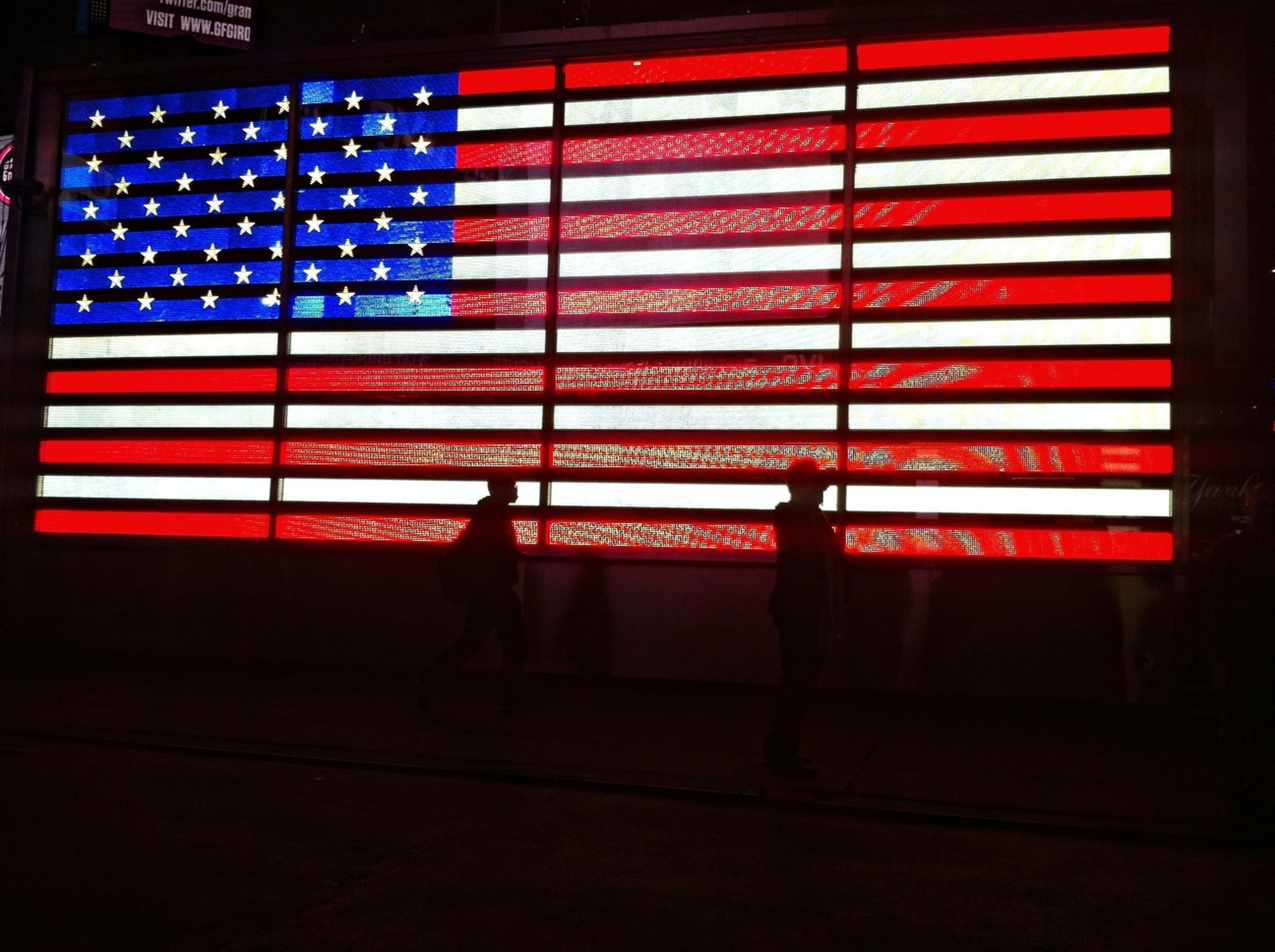 architecture, built structure, building exterior, red, american flag, flag, city, western script, patriotism, communication, text, striped, national flag, identity, city life, guidance, road sign, sign, information sign, illuminated