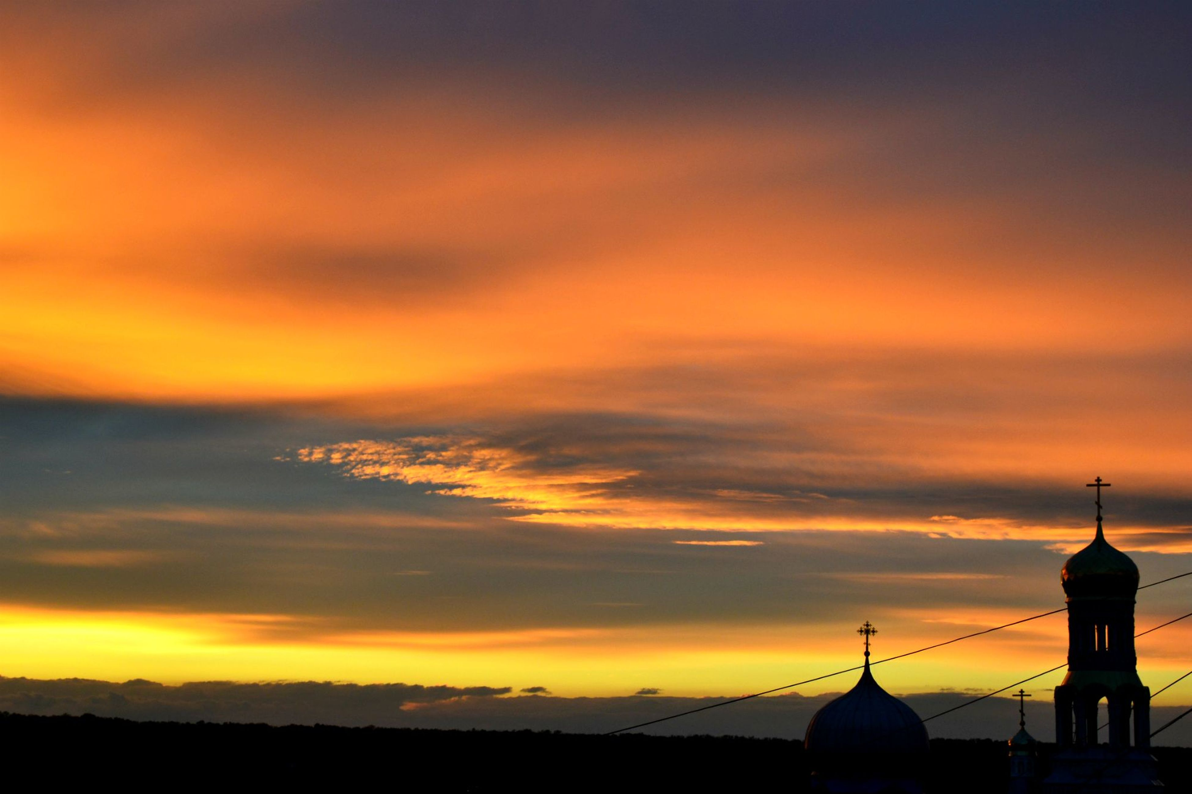 sunset, orange color, sky, architecture, built structure, building exterior, silhouette, scenics, beauty in nature, cloud - sky, dome, place of worship, religion, spirituality, dramatic sky, nature, idyllic, tranquility, cloud, outdoors
