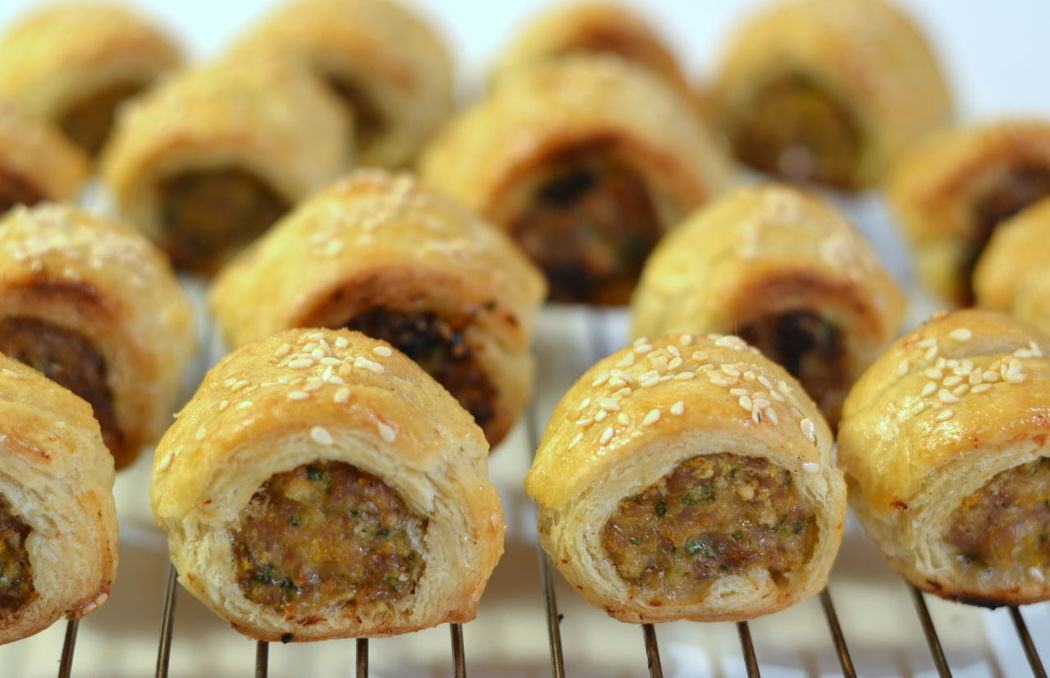 Sausage Rolls Appetiser Appetizer Baked British Cuisine British Food Brown Close-up Comfort Food Finger Food Food Food And Drink Homemade In A Row Indoors  Lunch Lunch Food Pastry Puff Pastry Ready-to-eat Sausage Sausage Rolls! Savoury Sesame Seed Garnish Tasty Wire Rack