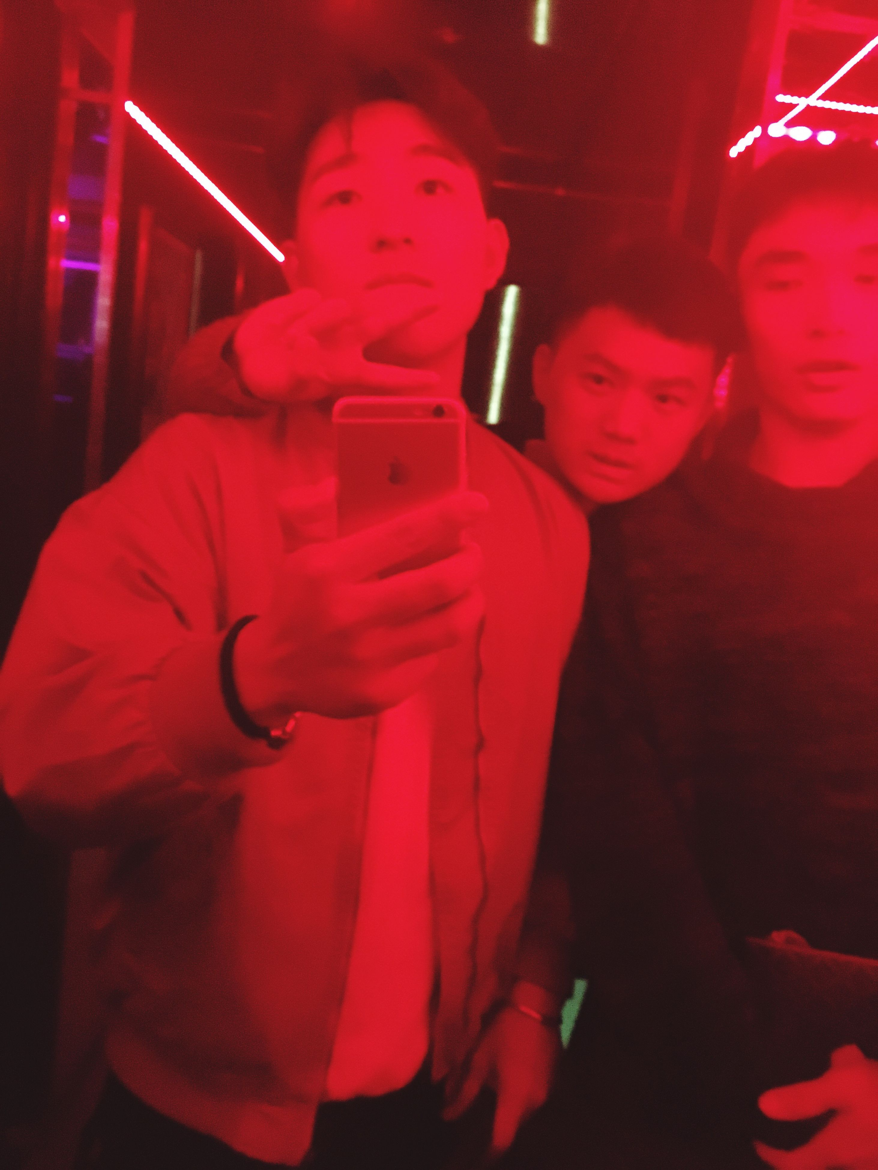 waist up, illuminated, night, red, casual clothing, enjoyment, nightclub, young adult, vibrant color, nightlife