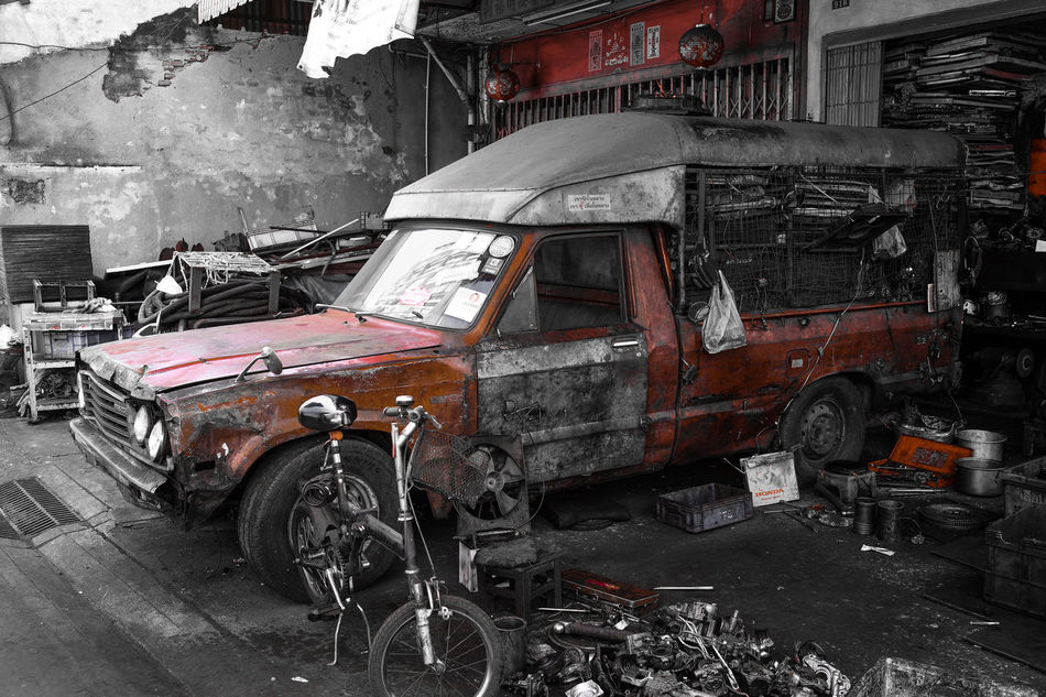 A derelict car in Bangkok Chinatown in front of a garage repair shop Abandoned Automotive Bangkok Building Exterior Car Cars Chinatown Chinatown Bangkok Day Derelict Garage Junk Land Vehicle Mode Of Transport No People Outdoors Repair Repairs Rust Scenery Tools Transportation Wrecker Finding New Frontiers