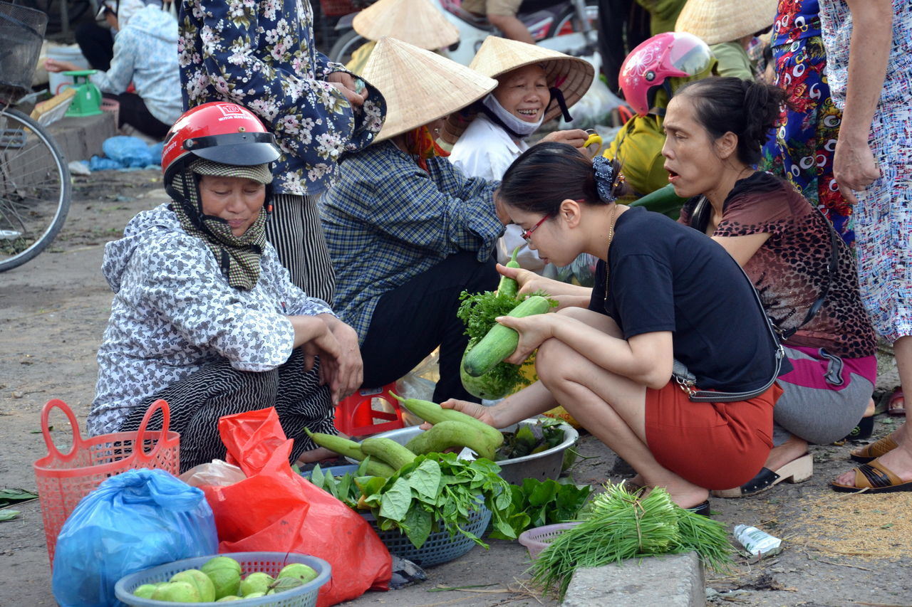 real people, vegetable, market, food and drink, day, crouching, togetherness, sitting, outdoors, freshness, lifestyles, healthy eating, food, women, men, young women, friendship, young adult, adult, people