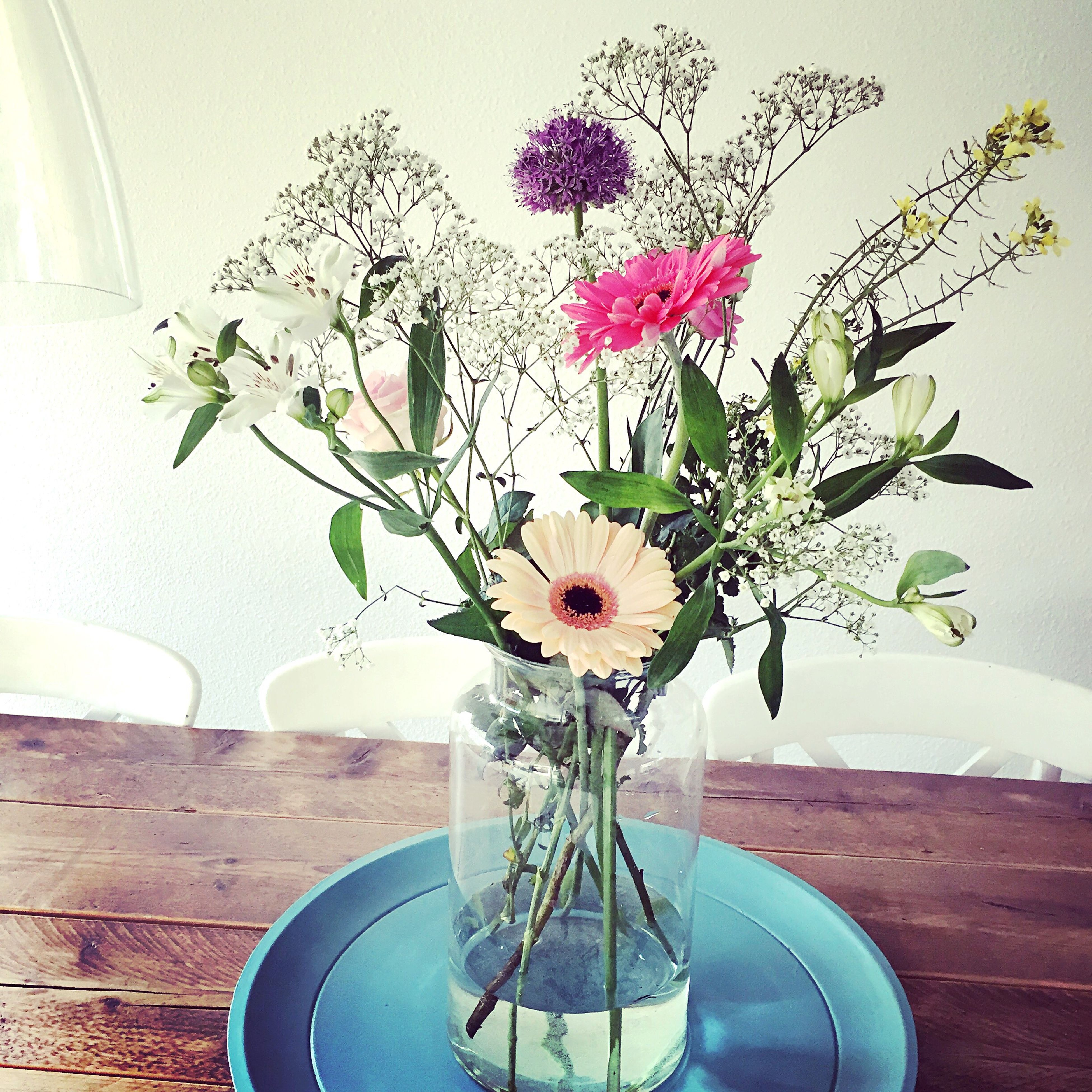 flower, vase, indoors, potted plant, freshness, fragility, wall - building feature, petal, plant, growth, flower pot, flower head, home interior, wall, decoration, stem, beauty in nature, table, flower arrangement, nature