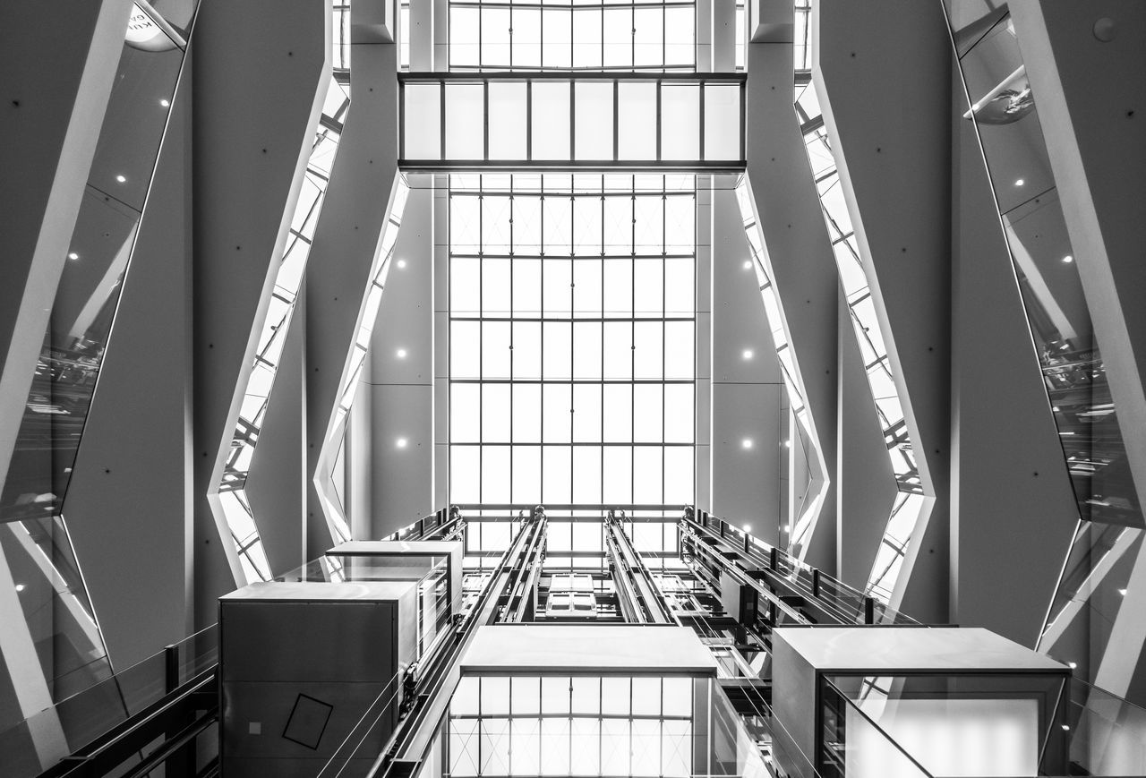 Black & White Elevator Futuristic Low Angle View Modern Architecture Architecture Black And White Built Structure Day Directly Below Glass - Material Indoors  Library Low Angle View Modern No People Railing Staircase Steps And Staircases Technology Window