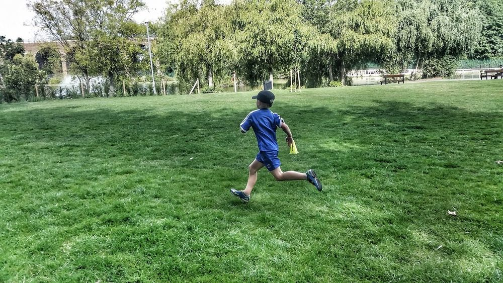 Park Run Boy Running Keeping Fit At The Park Running On The Grass Capturing Movement Photography In Motion