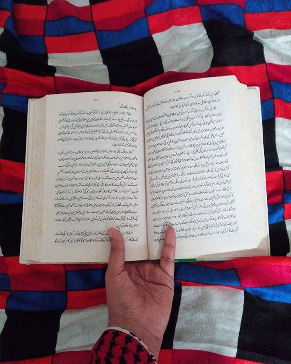 I can now finally do this book and my fellow Comrade justice Red Books Bookstagram MusaSeMarxTak FromMosesToMarx Vacationreading Urdu Translatedwork