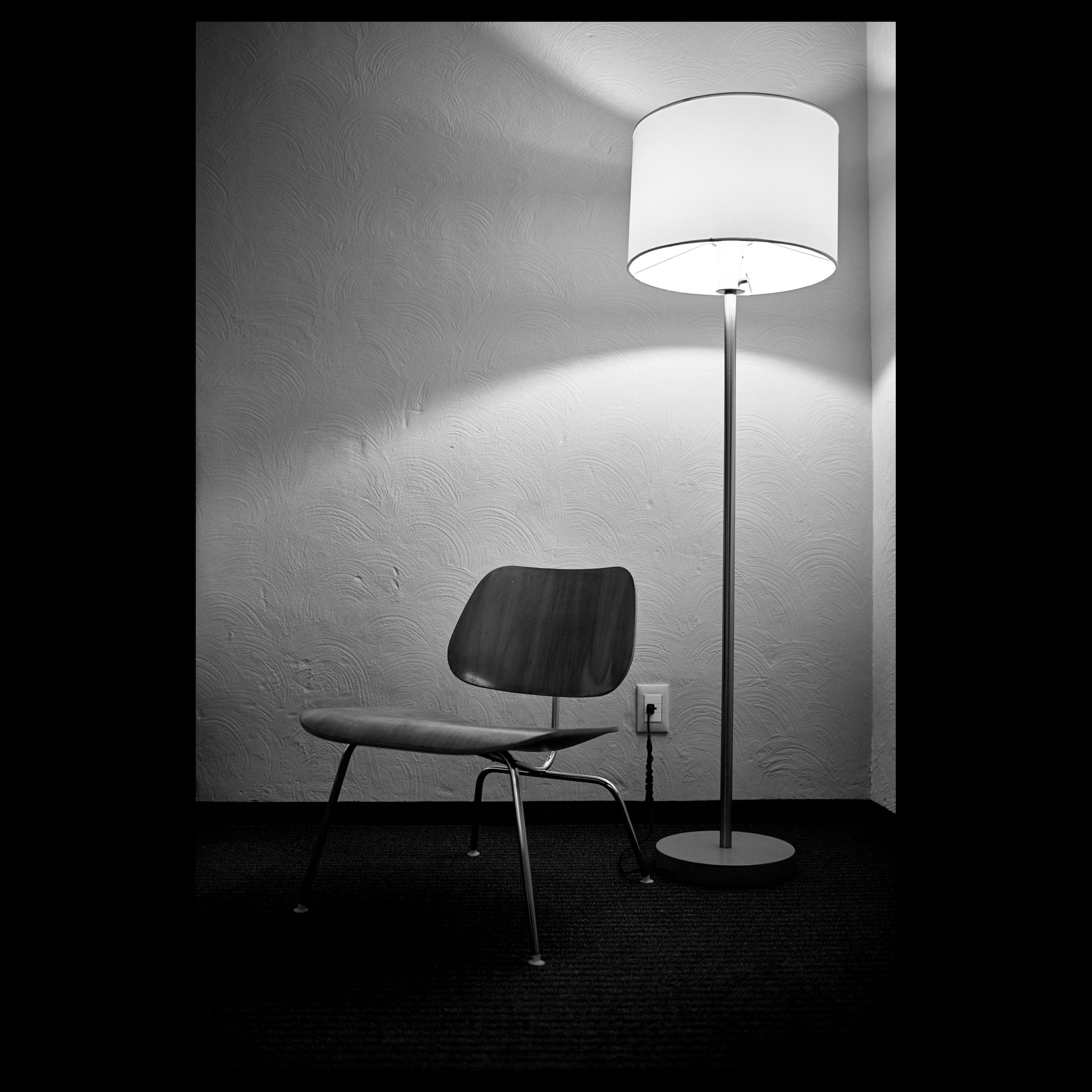 indoors, lighting equipment, illuminated, electric lamp, absence, chair, electric light, lamp, electricity, home interior, empty, wall - building feature, table, hanging, light - natural phenomenon, wall, ceiling, no people, lit, dark