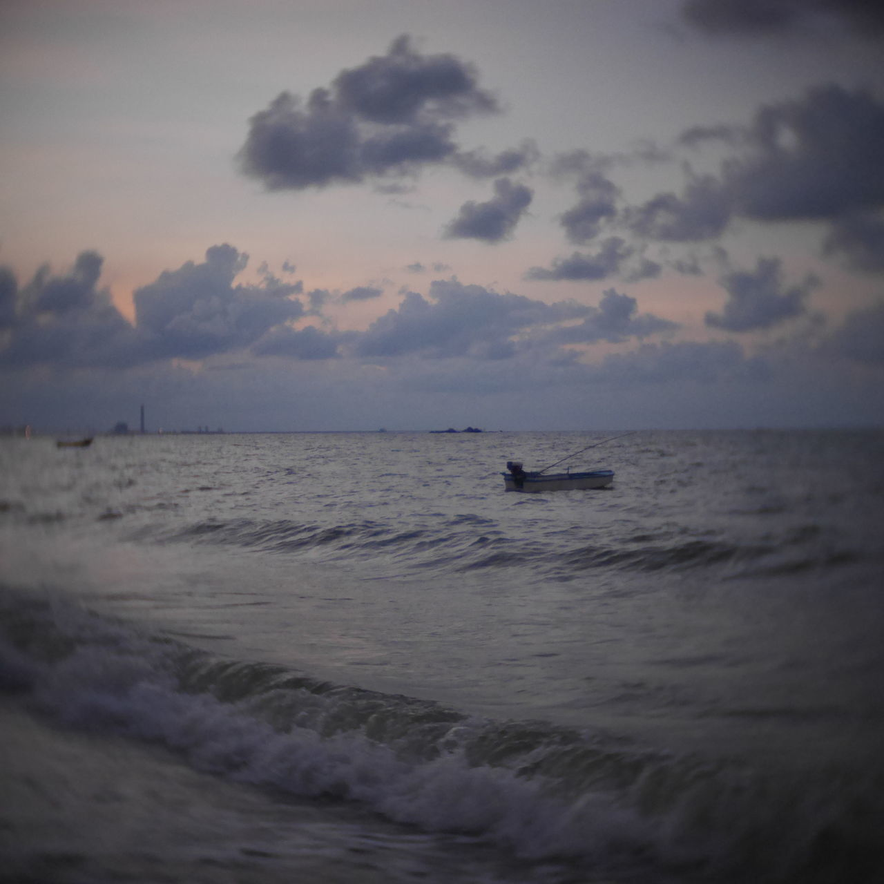 sea, water, horizon over water, sunset, nature, beauty in nature, sky, waterfront, scenics, tranquil scene, tranquility, silhouette, outdoors, nautical vessel, cloud - sky, beach, wave, one person, day, jet boat, people