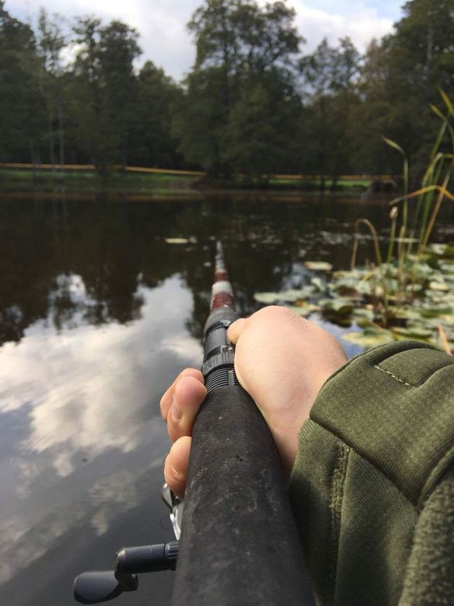Person One Person Real People Human Body Part Leisure Activity Personal Perspective Holding Day Men Sitting Outdoors Water Nature Close-up One Man Only People Adult Fishing Army Life FreeTime