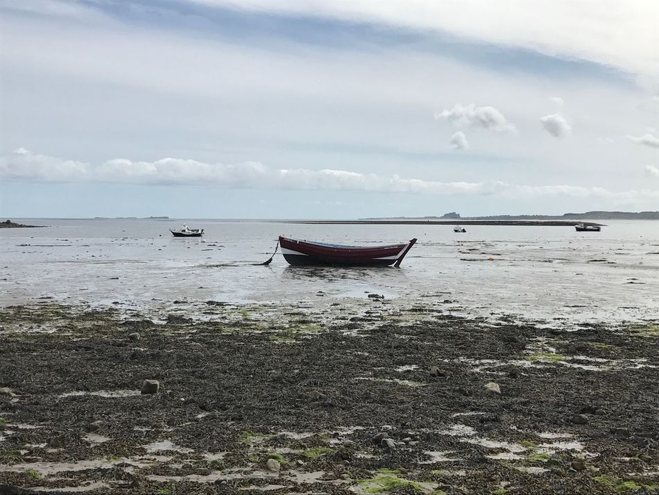 Boat in Lindesfarne harbour Beach Water Sea Sky Shore Nature Nautical Vessel Transportation Cloud - Sky Beauty In Nature Mode Of Transport Tranquility Scenics Horizon Over Water Tranquil Scene Sand Moored Outdoors No People Day