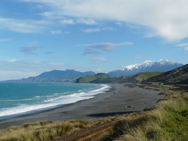 Beauty In Nature Black Sand Beach Day Idyllic Kaikoura Landscape Mountain Mountain Range Nature New Zealand Beauty New Zealand Scenery Non-urban Scene Outdoors Remote Scenics Sky Snowcapped Mountains Tranquil Scene Tranquility