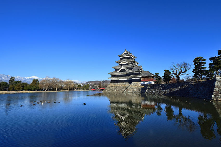 Castle Matsumoto CITY Matsumoto Castle / Japan MatsumotoCastle Nagano, Japan Architecture Beauty In Nature Blue Building Exterior Built Structure Clear Sky Day History Lake Nature No People Outdoors Place Of Worship Religion Sky Spirituality Travel Destinations Tree Water