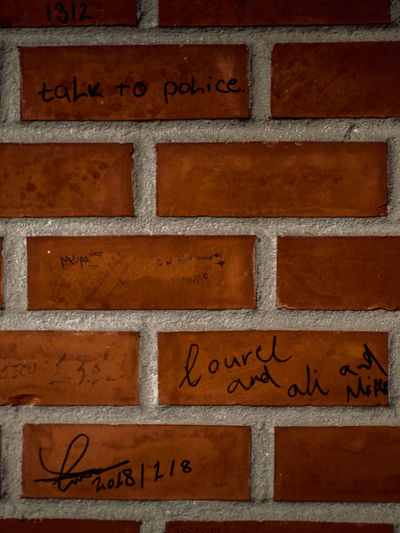 Textures and Surfaces Texture Patttern Brickwall Text Western Script Communication Wall - Building Feature Wood - Material Brick Wall Outdoors Day No People Nameplate Full Frame Textured  Architecture Close-up Information Backgrounds Textured  Built Structure