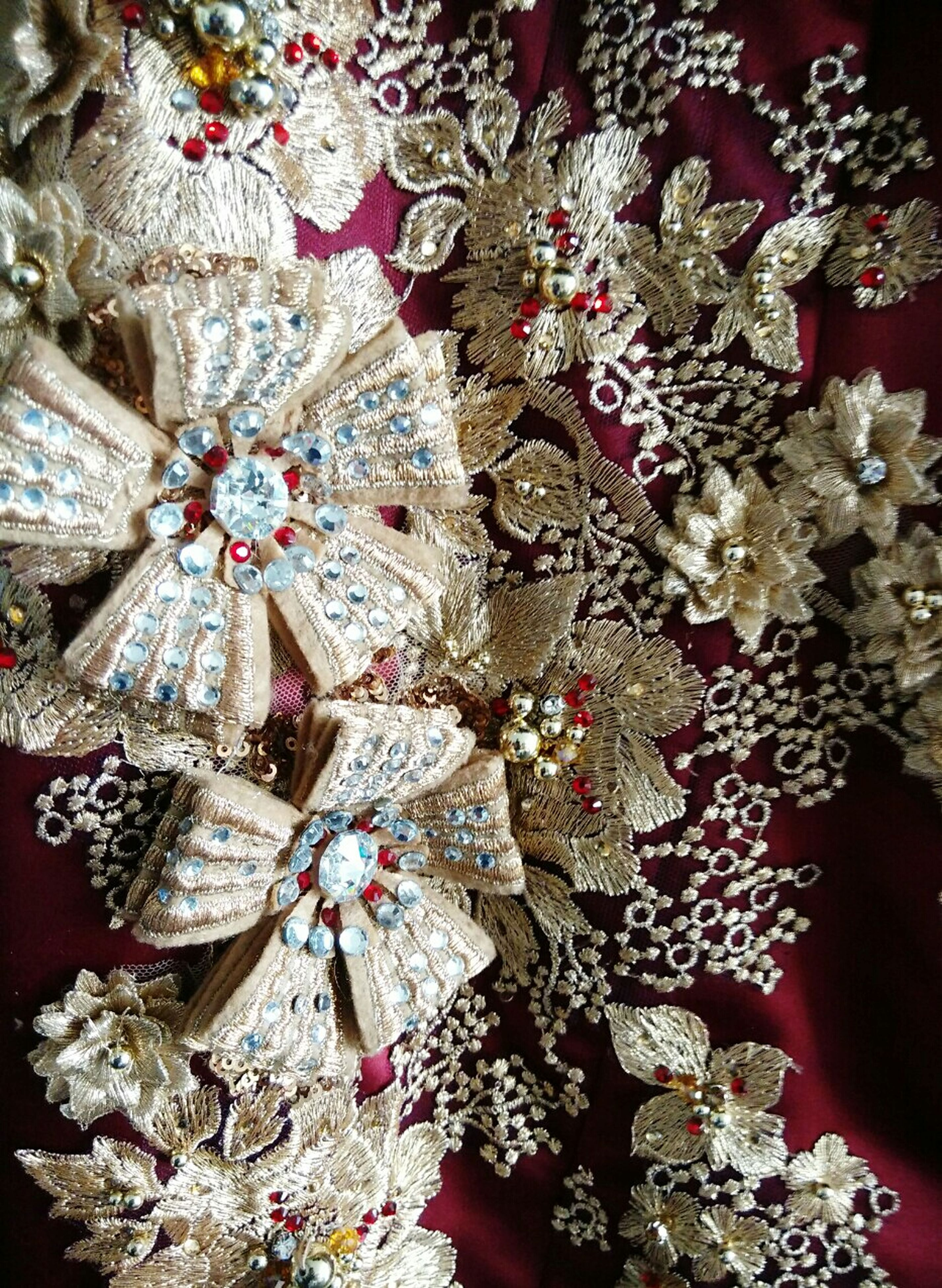 indoors, flower, art and craft, art, creativity, decoration, close-up, high angle view, floral pattern, tradition, multi colored, design, cultures, variation, textile, still life, fragility, bouquet, fashion, fabric