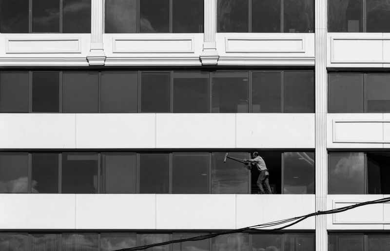 Architecture Black & White Black And White Blackandwhite Built Structure Cleaning Cleaning Glasses Clear Sky Closed Door EyeEm Best Shots EyeEm Best Shots - Black + White Full Frame Glass - Material Man Pattern Safety Structure Wall Wall - Building Feature Window