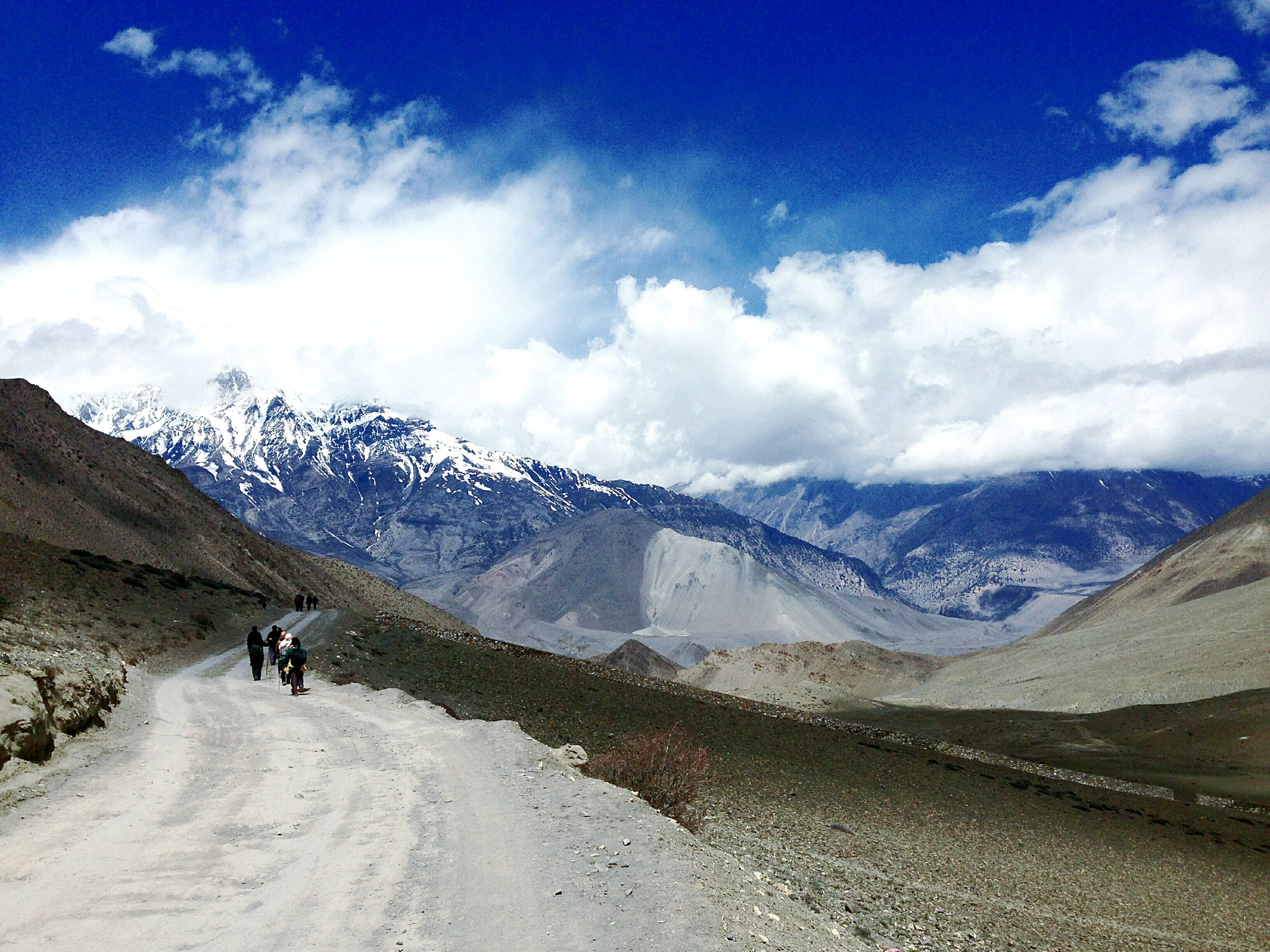 mountain, snow, winter, cold temperature, mountain range, sky, leisure activity, season, snowcapped mountain, tranquil scene, lifestyles, men, scenics, beauty in nature, tranquility, landscape, cloud - sky, weather
