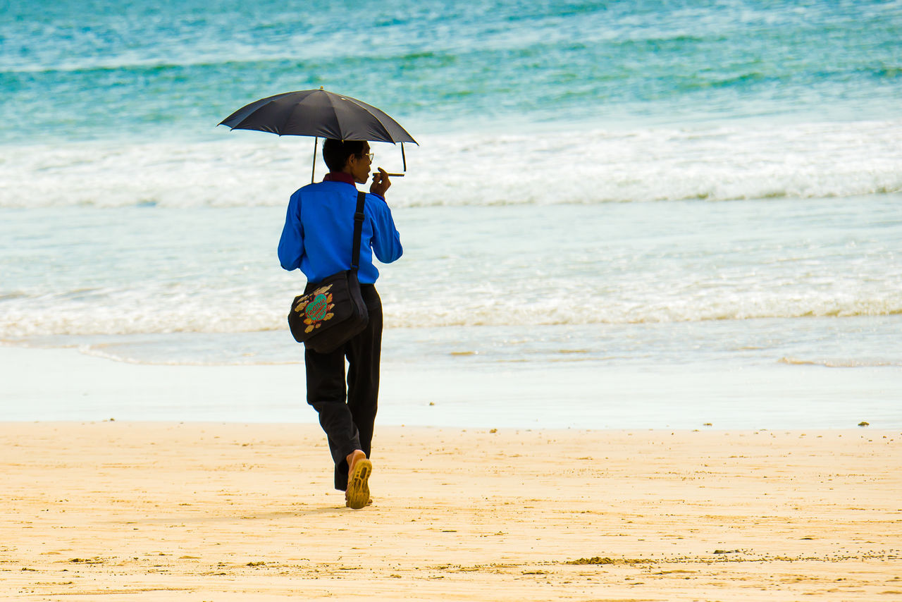 Bay Of Bengal Beach Beauty In Nature Day Full Length Horizon Over Water Leisure Activity Lifestyles Nature in Ngapali Beach, Myanmar One Man Only Outdoors People Real People Sand Scenics Sea Shore Sky Sommergefühle Umbrella Walking Water Wave