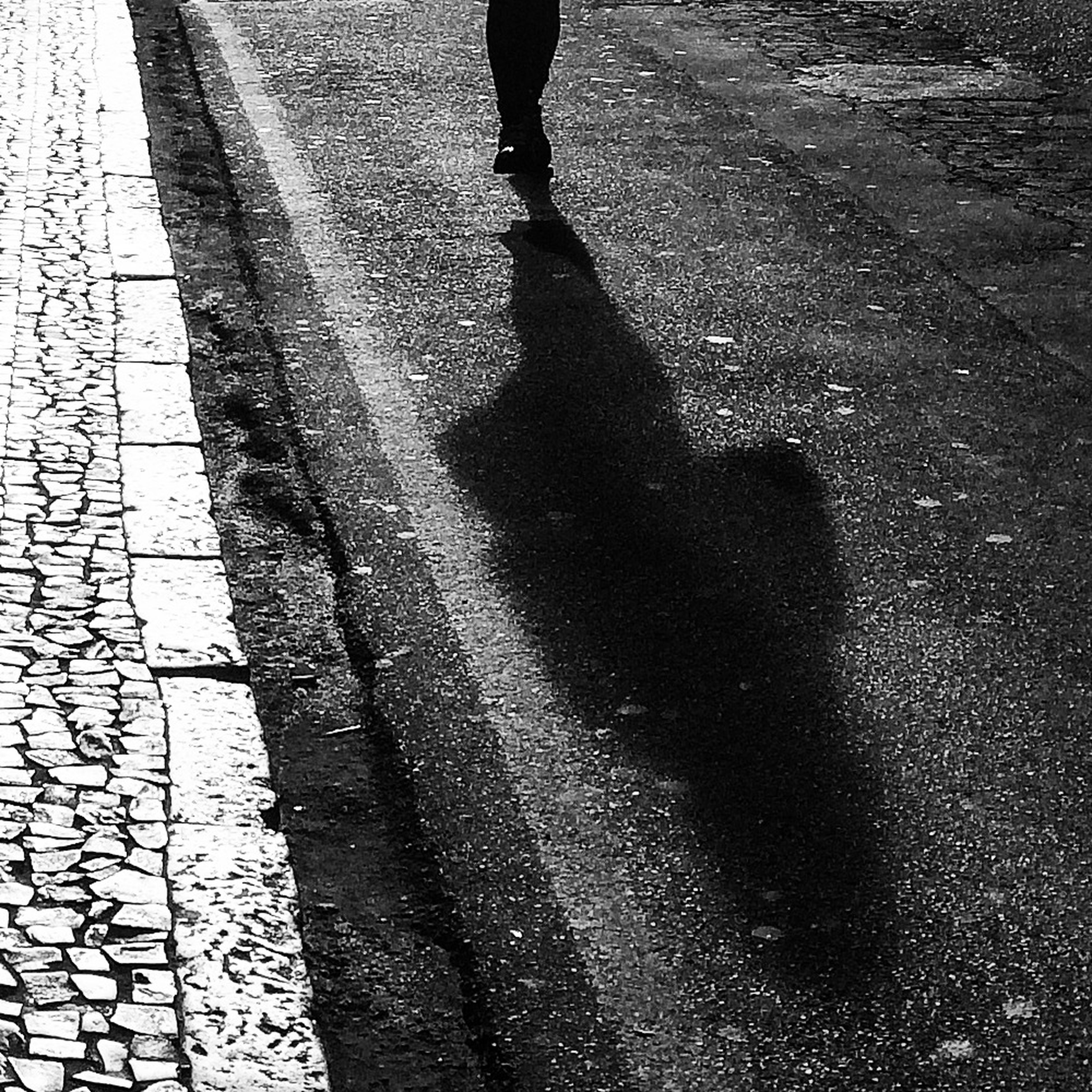 low section, person, street, shadow, lifestyles, walking, road, leisure activity, standing, unrecognizable person, sunlight, high angle view, men, sidewalk, asphalt, human foot