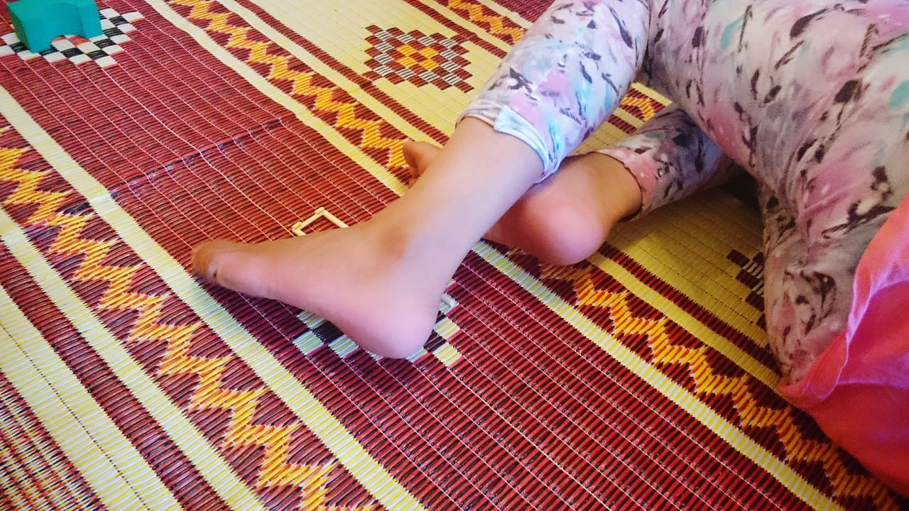 childhood, indoors, low section, one person, human body part, rug, baby, home interior, barefoot, pattern, one girl only, children only, child, human leg, people, real people, multi colored, day, close-up, adult