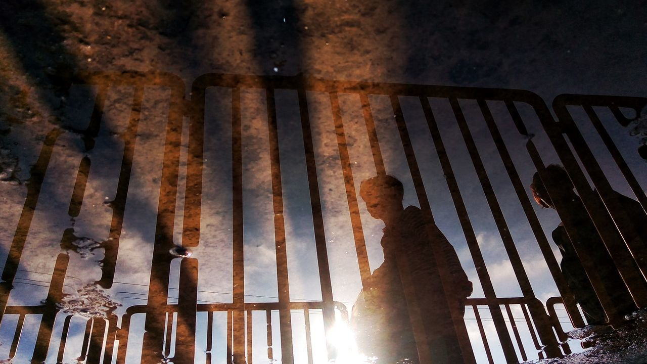 sunlight, low angle view, real people, indoors, day, standing, prison, nature, close-up