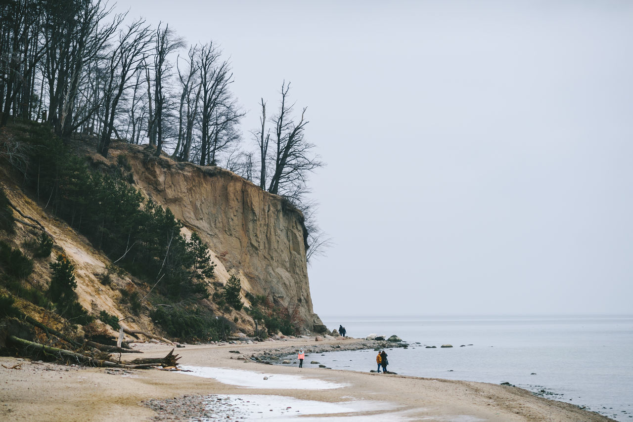 Cliff Adult Adults Only Baltic Sea Beach Beauty In Nature Day ExploreEverything Leisure Activity Lifestyles Nature Outdoors People Real People Scenics Sea Sky Tranquil Scene Tranquility Tree Vacations Water Winter