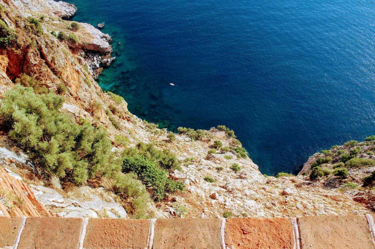 high angle view, no people, sea, nature, scenics, beauty in nature, outdoors, day, cliff, architecture, water
