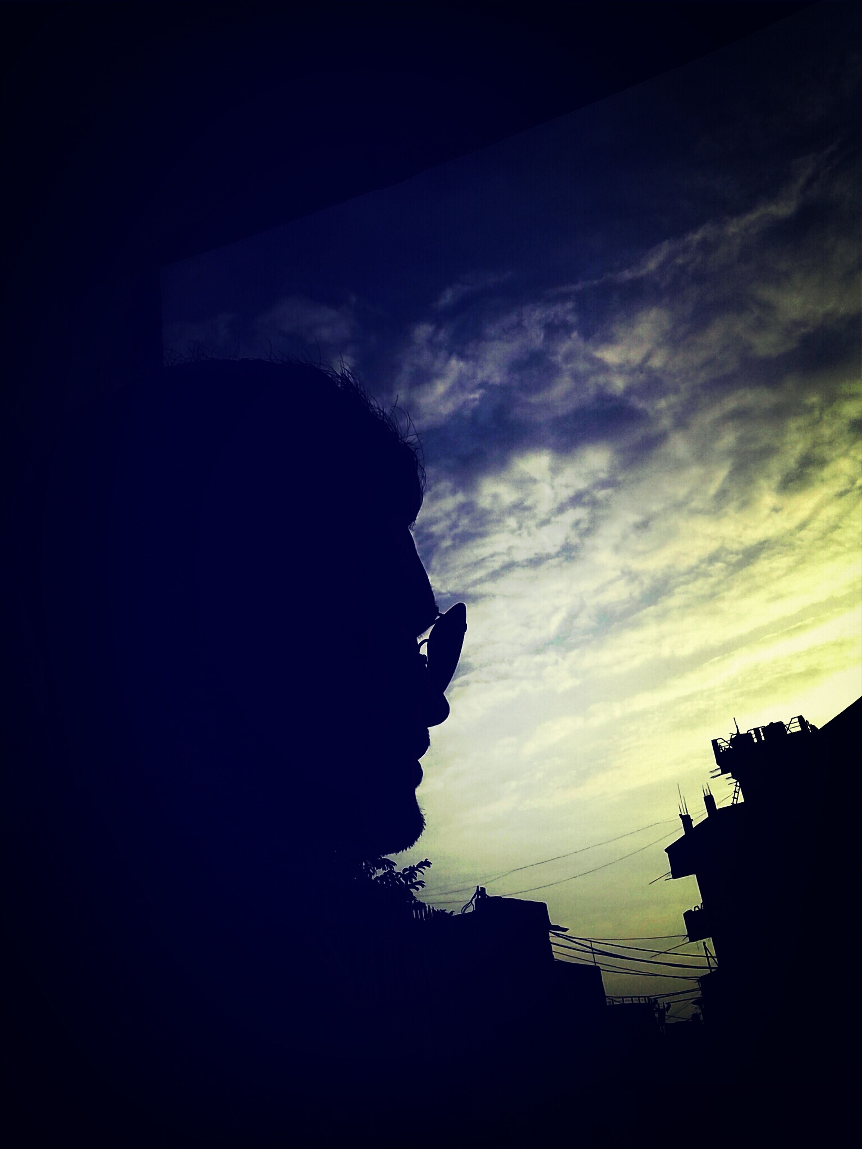 silhouette, sky, built structure, architecture, building exterior, low angle view, sunset, outline, cloud - sky, dark, dusk, cloud, cloudy, building, outdoors, copy space, nature, no people, city, weather