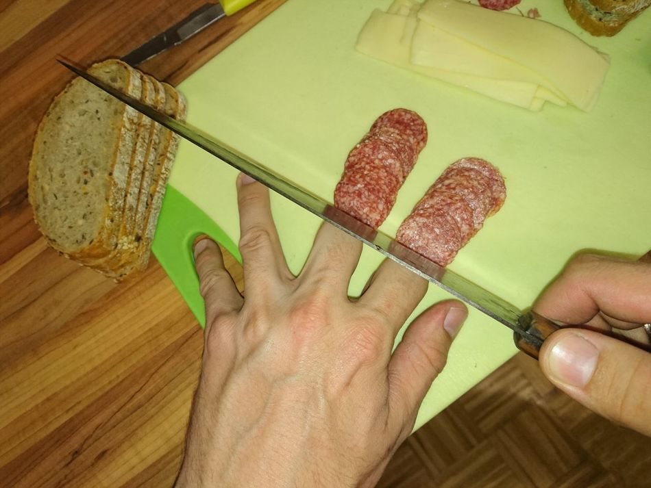 Cutting sausage-fingers Break The Mold Human Body Part Indoors  High Angle View One Person People Adult Adults Only Day Close-up Only Men Cut Cutting Cutting Board Sausage Salami Fingers Finger Hand Human Hand
