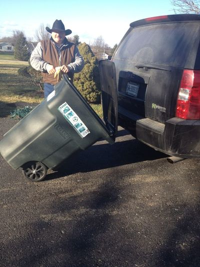 My dad's redneck way of bringing the trash cans back up to the house... Hook it to the hitch haha