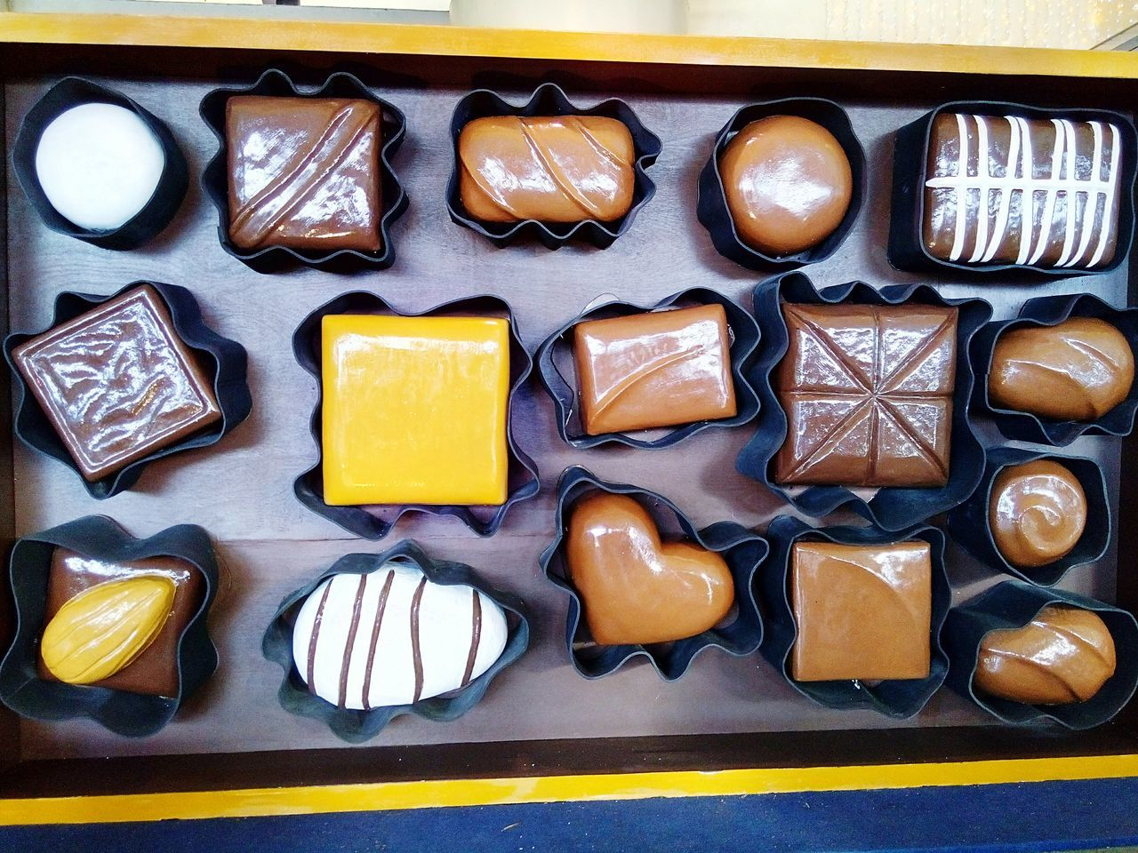 Directly Above View Of Fresh Chocolates In Tray