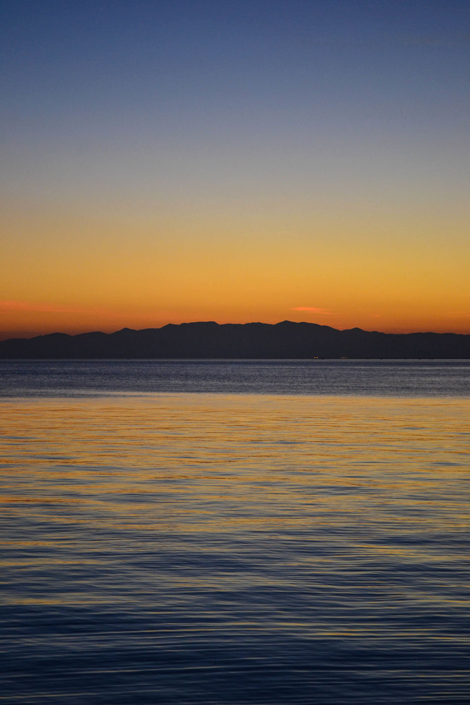 The mountain and the sea Thessaloniki Salonicco Greece Grecia Mountain Sea Sunset Reflection Orange Waves Nature Sky Skyporn Landscape Water Outdoors Scenics Beauty In Nature Horizon Over Water