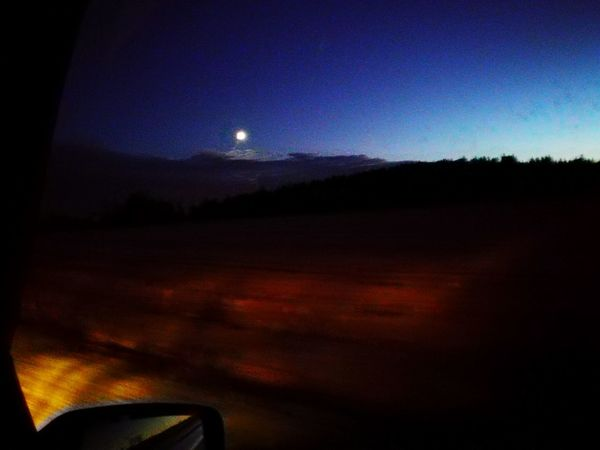 Transportation Mode Of Transport Moon Tranquil Scene Dirt Road Scenics Car Part Of Travel Tranquility Night Land Vehicle Non-urban Scene Beauty In Nature Outdoors Nature Sky Travel Destinations Mountain Blue