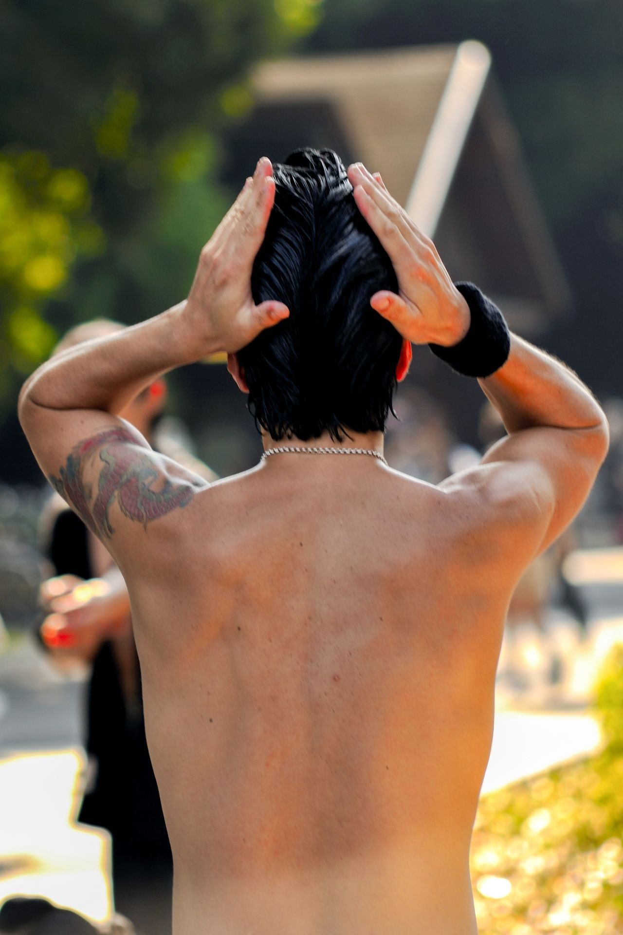 A 50's style Rocker's fixing his hair at Yoyogi Park, Tokyo, Japan. 50's Style Close-up Day Focus On Foreground Hair Hairdye Human Hand Leisure Activity Lifestyles One Person Outdoors Real People Rear View Rock N Roll Rocker Shirtless Standing The Portraitist - 2017 EyeEm Awards