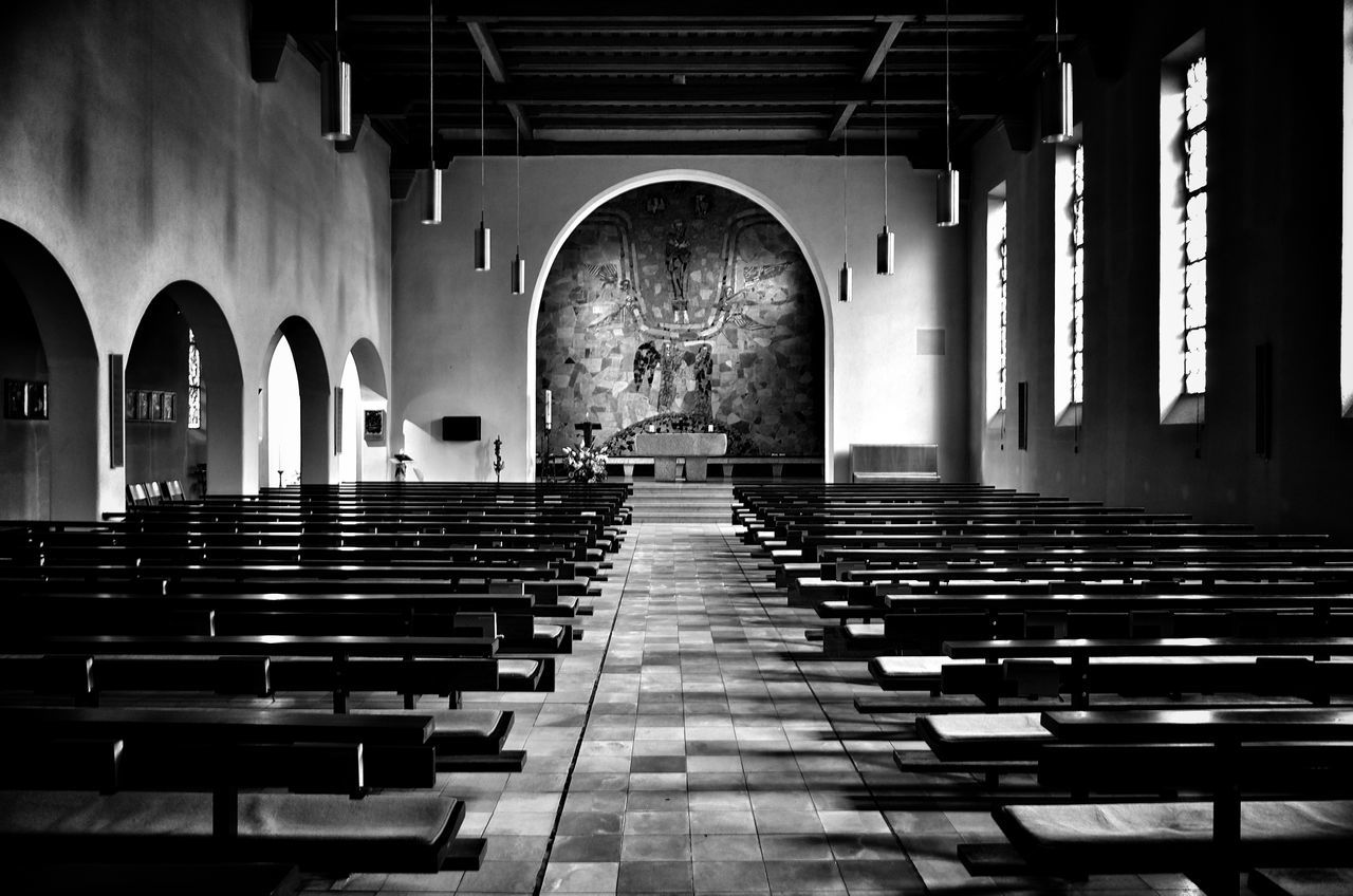 arch, religion, indoors, pew, place of worship, in a row, spirituality, no people, seat, architecture, day