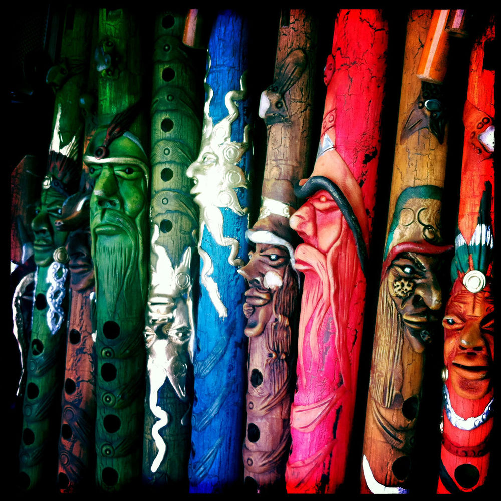 These flutes looked like mini-Ents. Carved Colourful Faces Flute Flutes Glasgow  Glashow Hipstamtic Instruments IPhone Large Group Of Objects Macros Market Multi Colored Music Scotland Square Stall Vintage