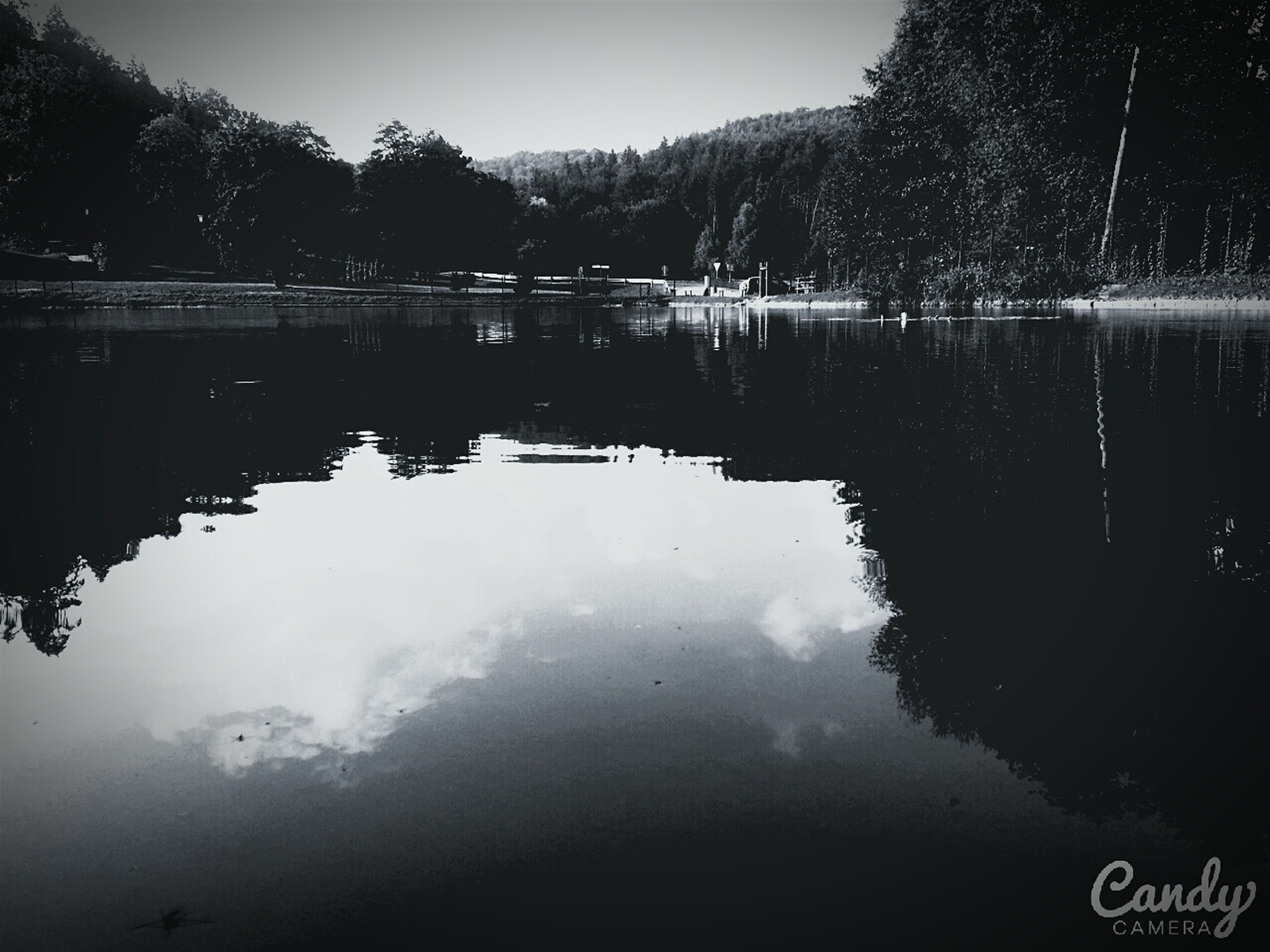 reflection, water, lake, waterfront, standing water, tranquility, tranquil scene, scenics, beauty in nature, nature, tree, sky, calm, symmetry, no people, clear sky, idyllic, outdoors, day, wet