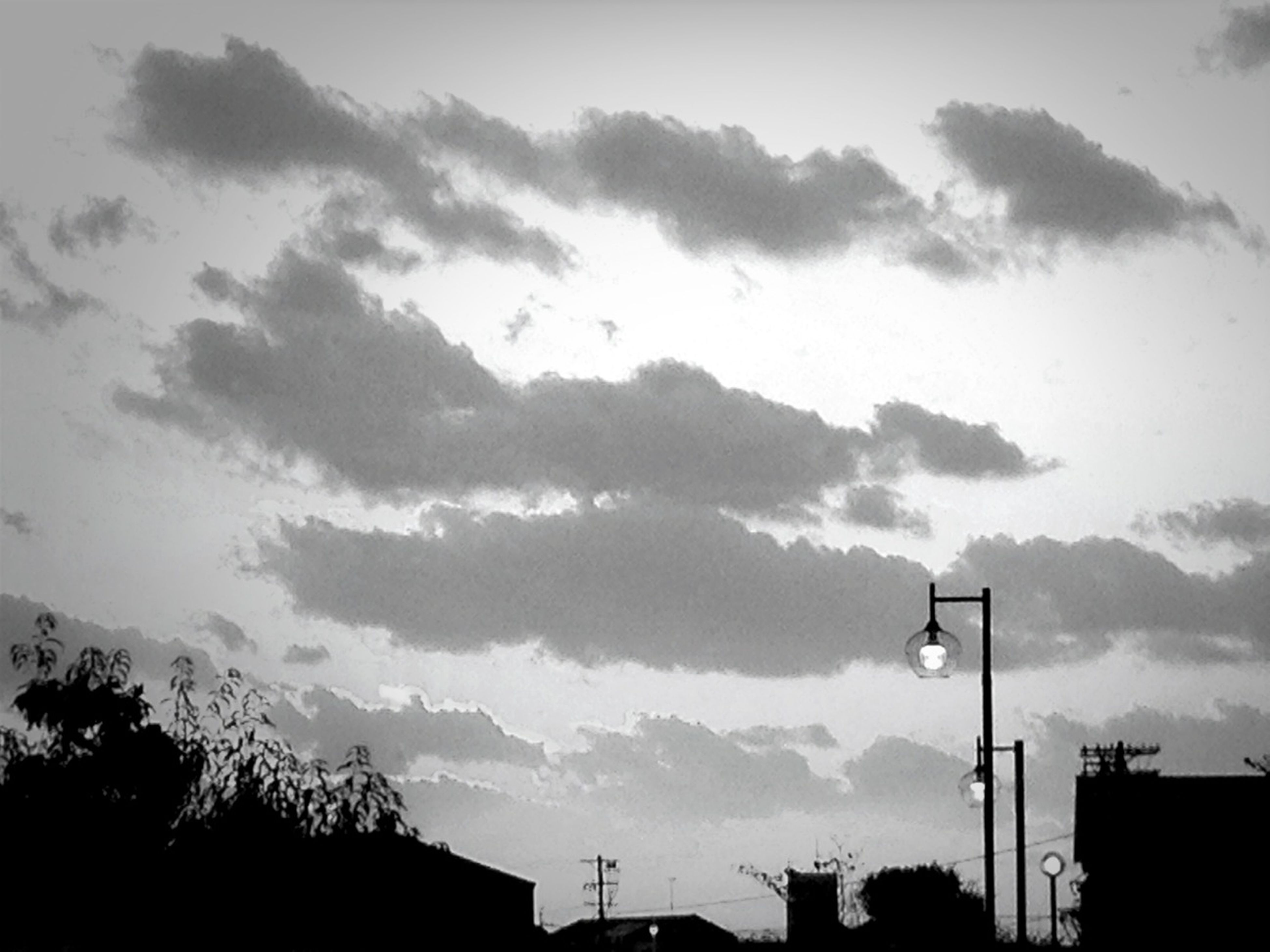 sky, silhouette, low angle view, building exterior, built structure, architecture, cloud - sky, cloudy, cloud, tree, high section, nature, weather, dusk, building, outdoors, overcast, beauty in nature, house, no people