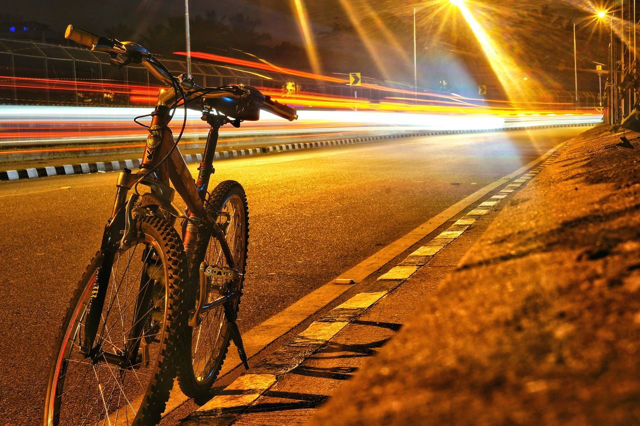 transportation, speed, mode of transport, blurred motion, illuminated, land vehicle, long exposure, motion, light trail, no people, night, road, outdoors