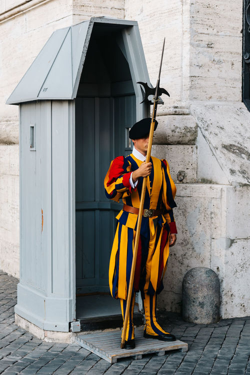 Soldiers of Swiss Guards in the entrance to Vatican City in Rome Architecture Army Basilica Building Exterior Built Structure Day Full Length Guards Lifestyles One Person Outdoors People Pope Real People Romans Soldier Swiss Swiss Guard Travel Destination Travel Destinations Uniform Vatican Vatican City